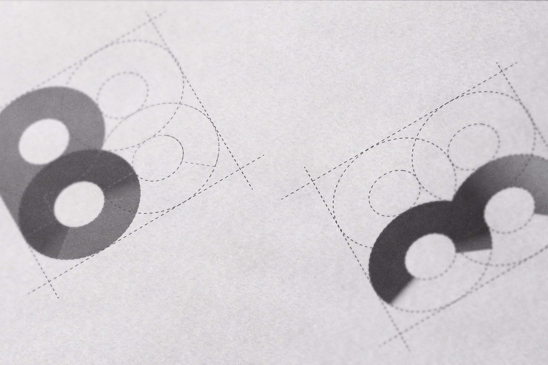 A close up of the Barton Milne Associates logo design development