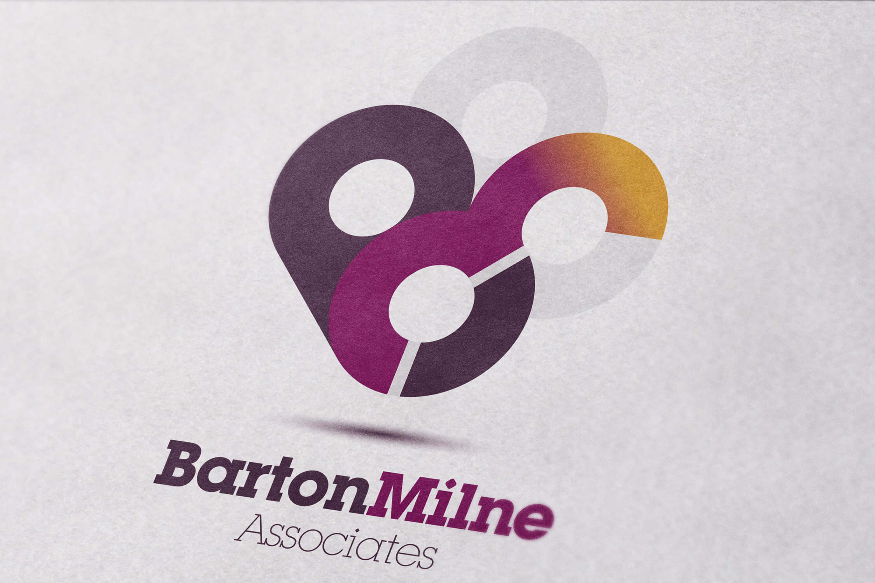 A close up of the Barton Milne Associates colour logo on white page