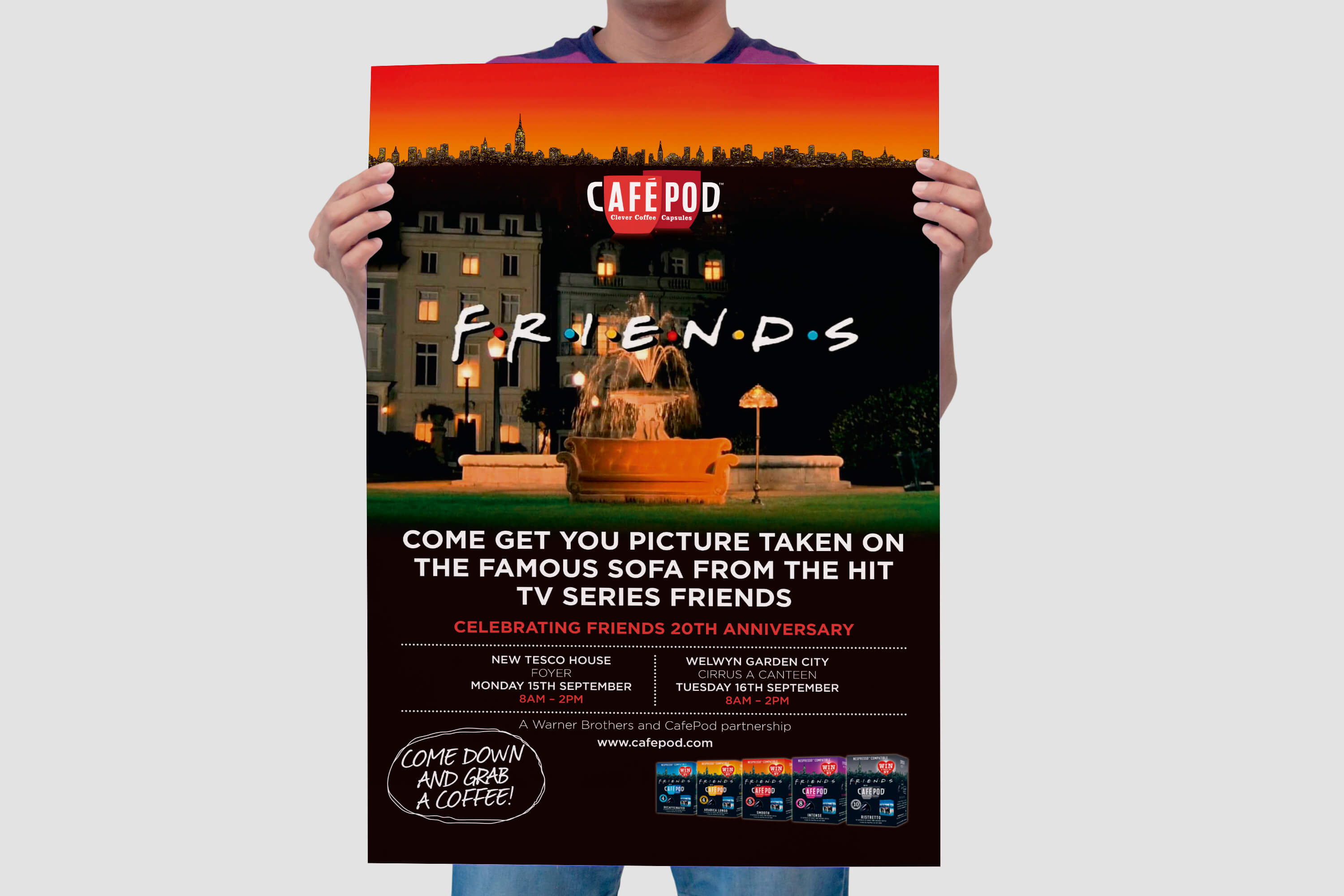A person holding a designed copy of a CaféPod Friends promotional poster