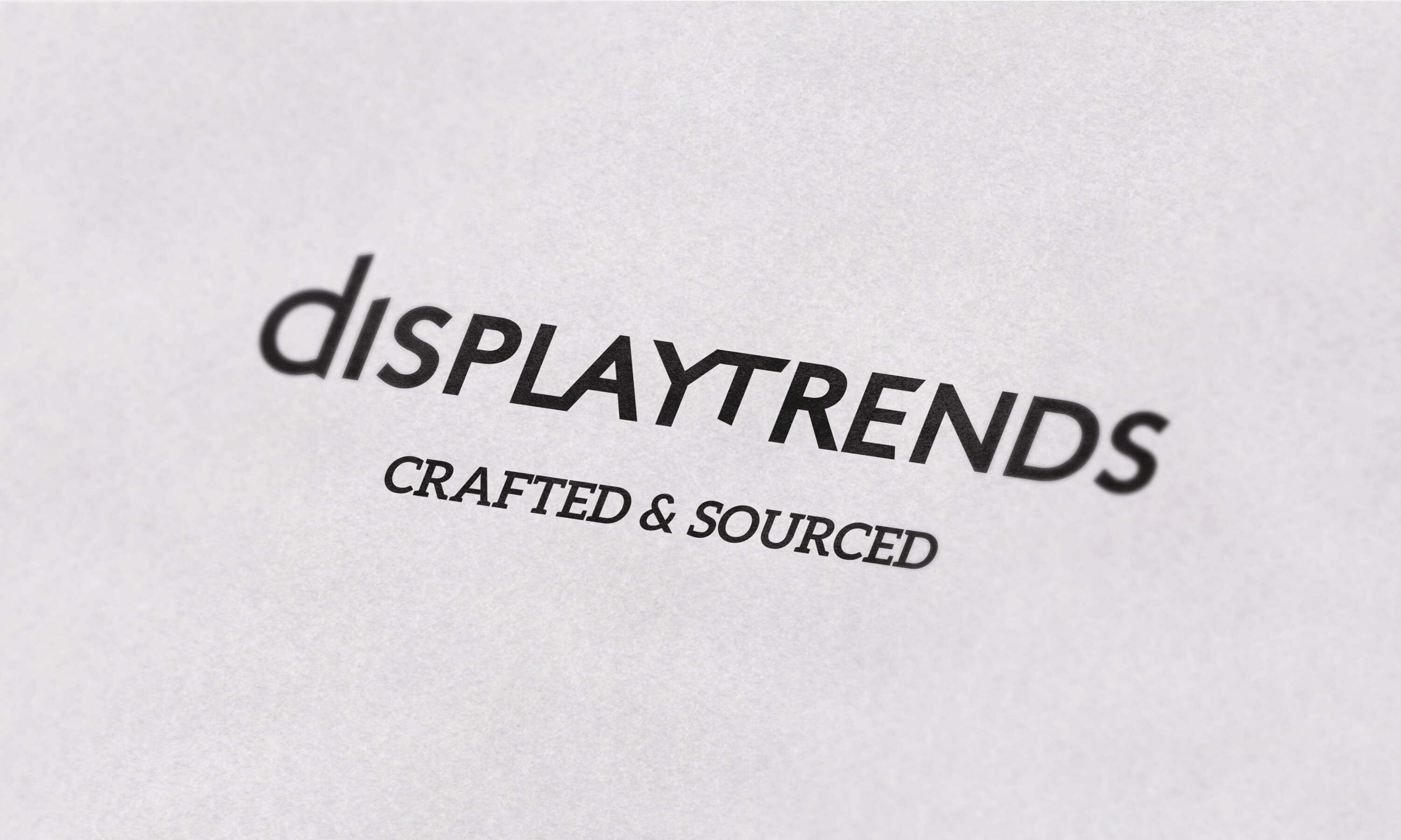 Close up of the Display Trends logo on white paper