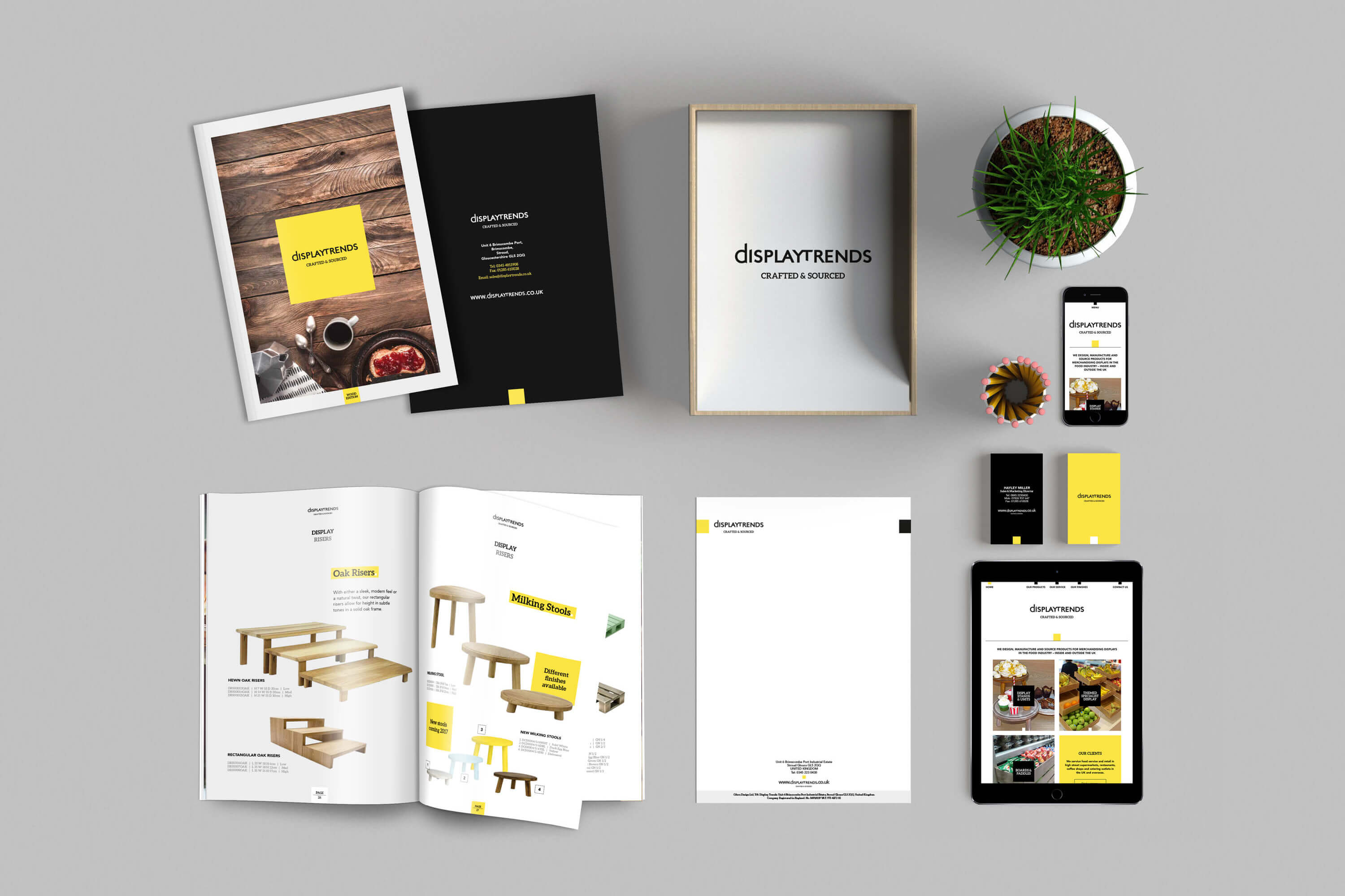 Shot looking down on Display Trends catalogue, letterhead, business cards and website design