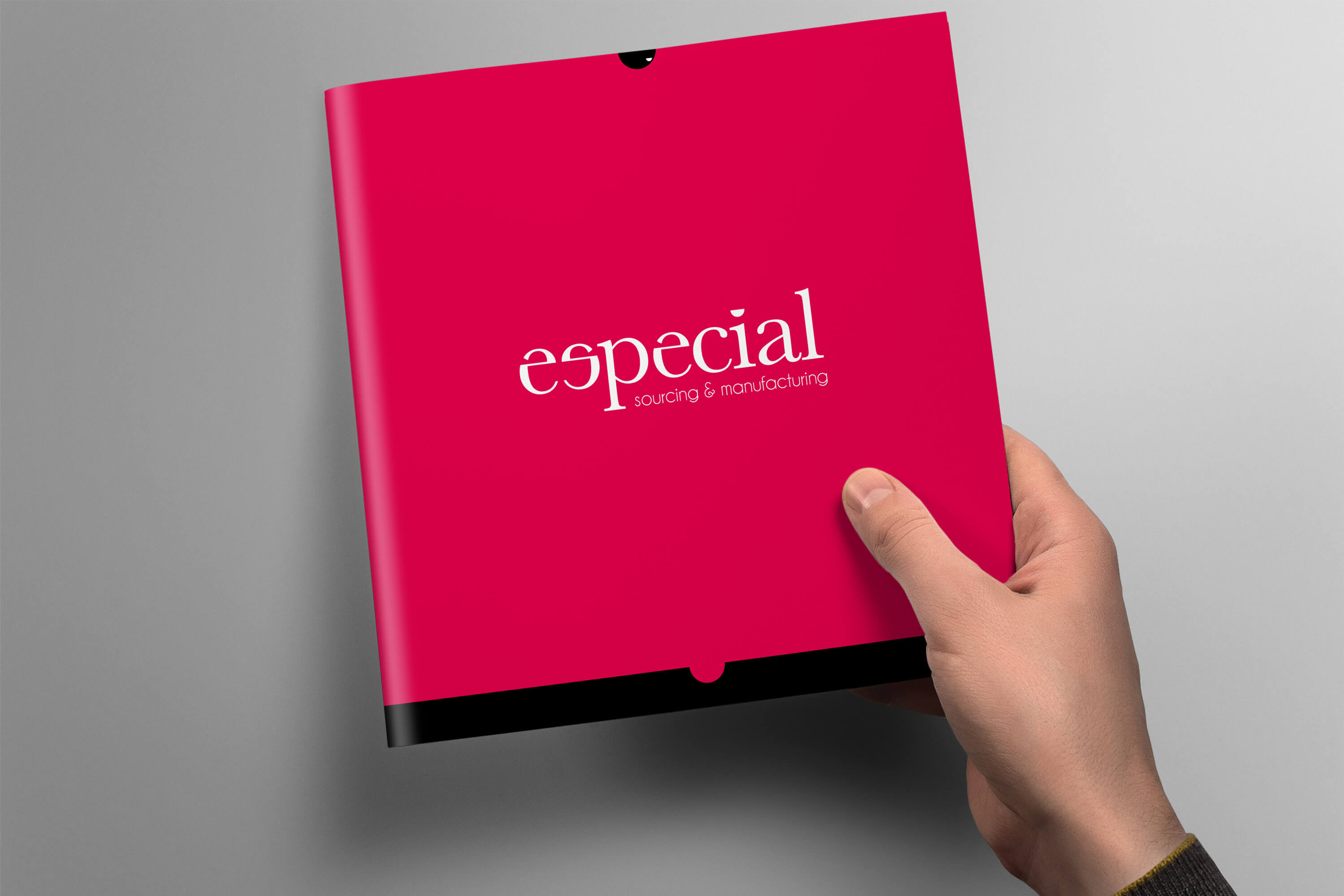 Hand holding an Especial Sourcing and Manufacturing brochure to show the cover