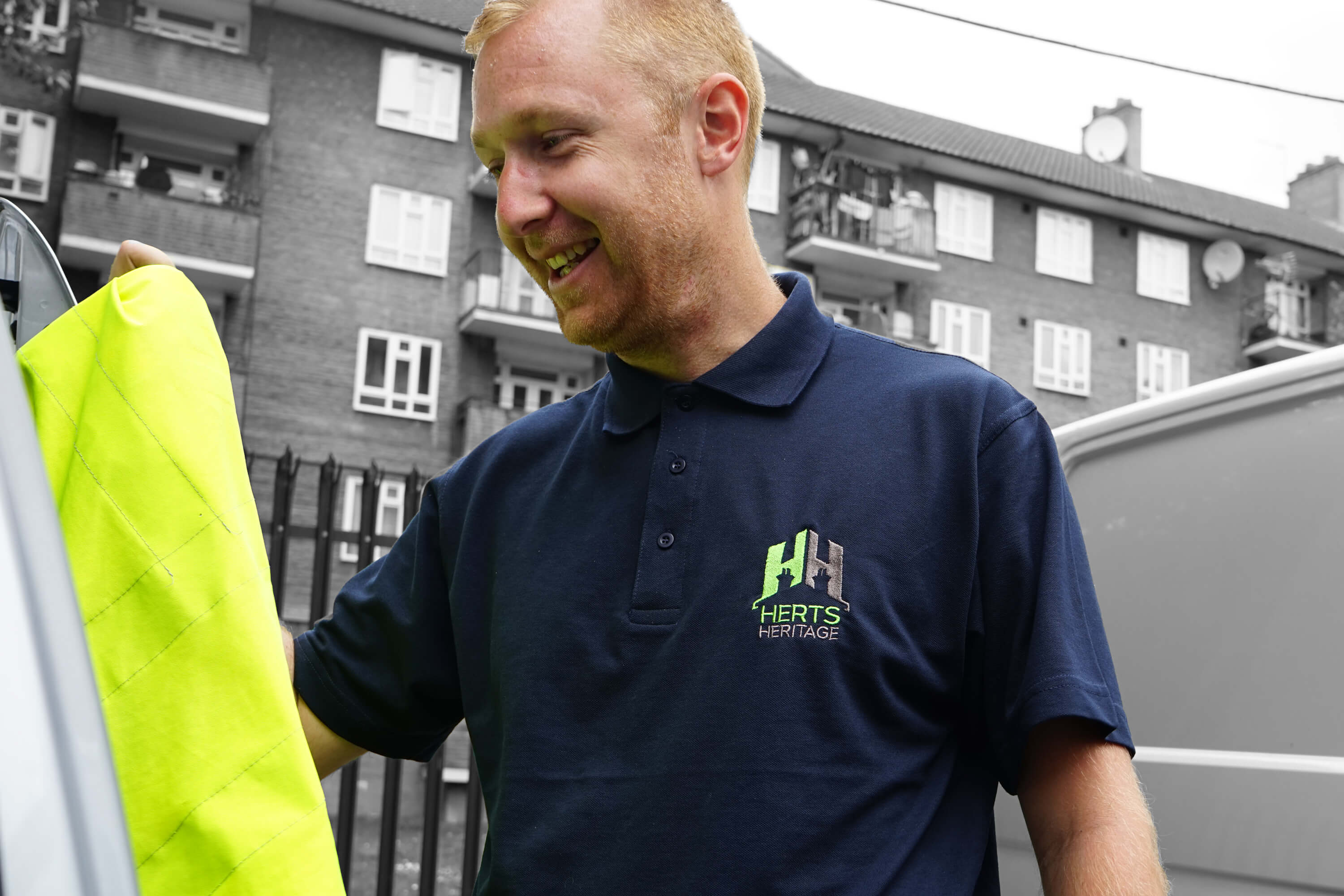 A Herts Heritage employee wearing a new shirt with Herts Heritage rebrand design