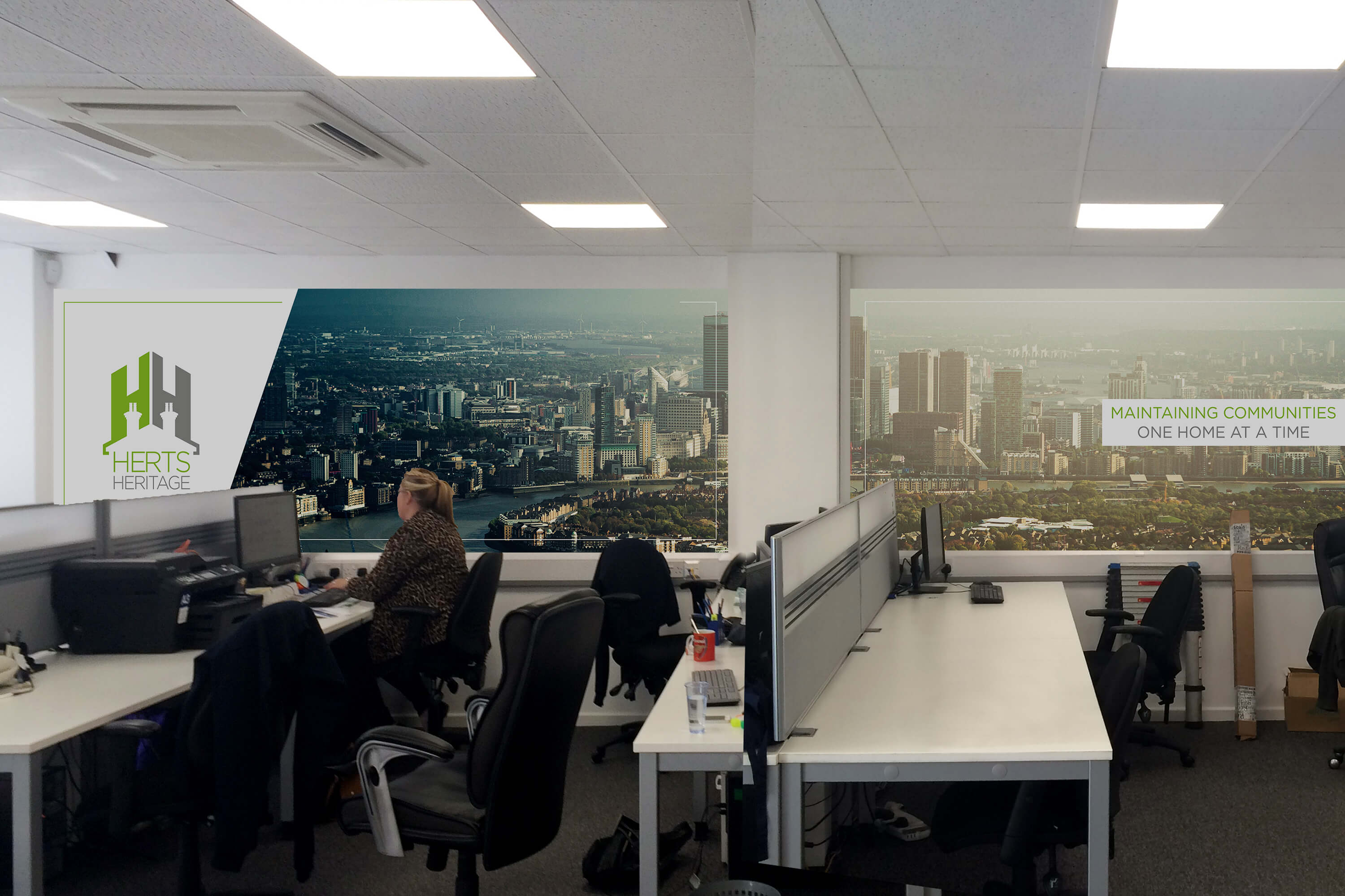 Internal office shot with design for Herts Heritage wall art in new rebrand style