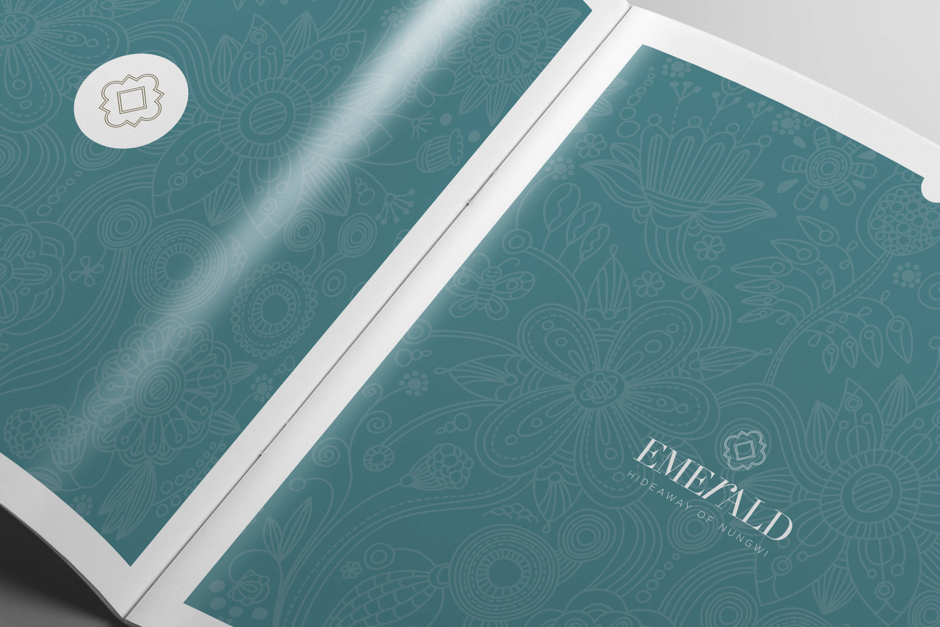 Open copy of the JLL Emerald Resorts corporate brochure showing pattern detail