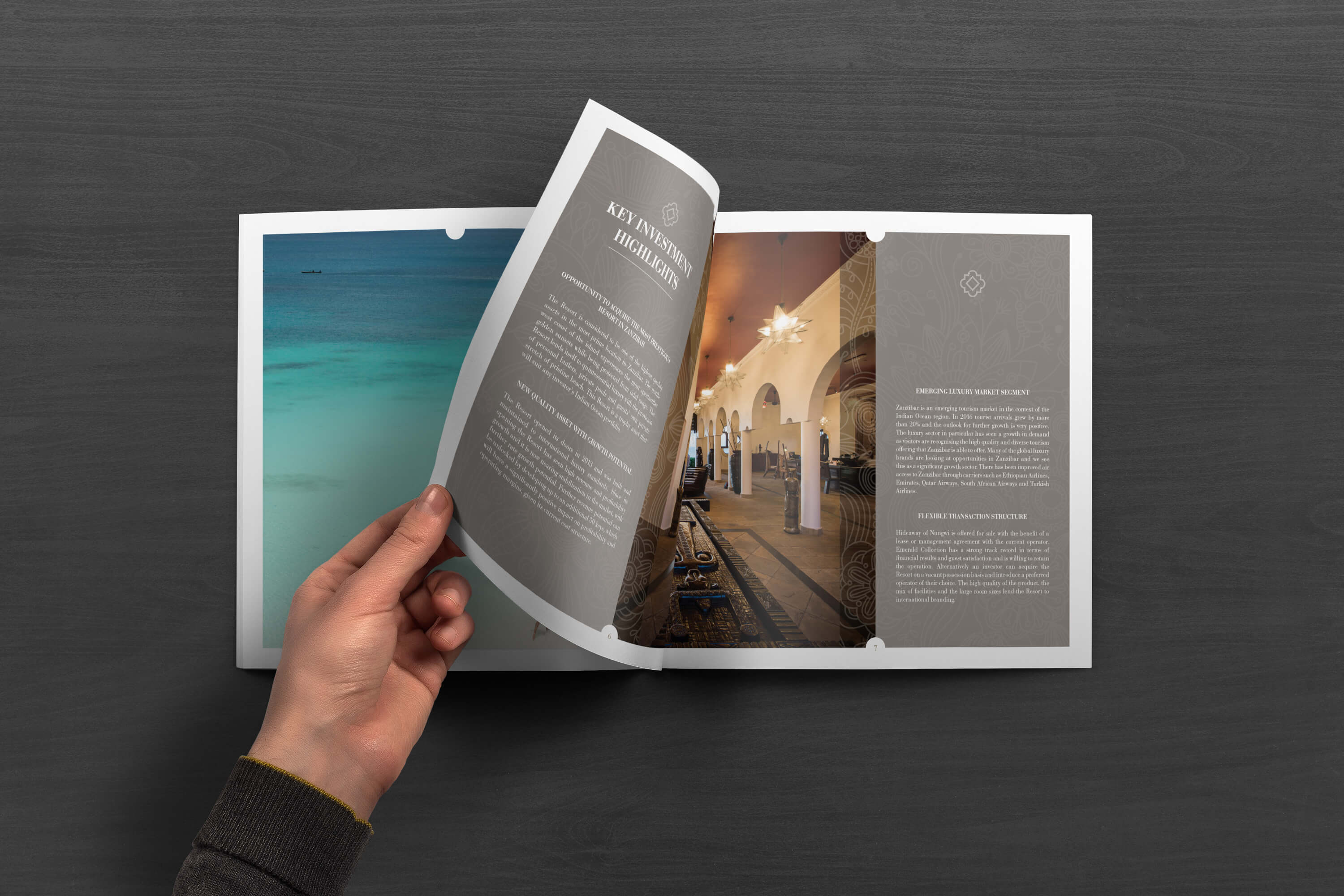 Person turning pages of the JLL Emerald Resorts corporate brochure