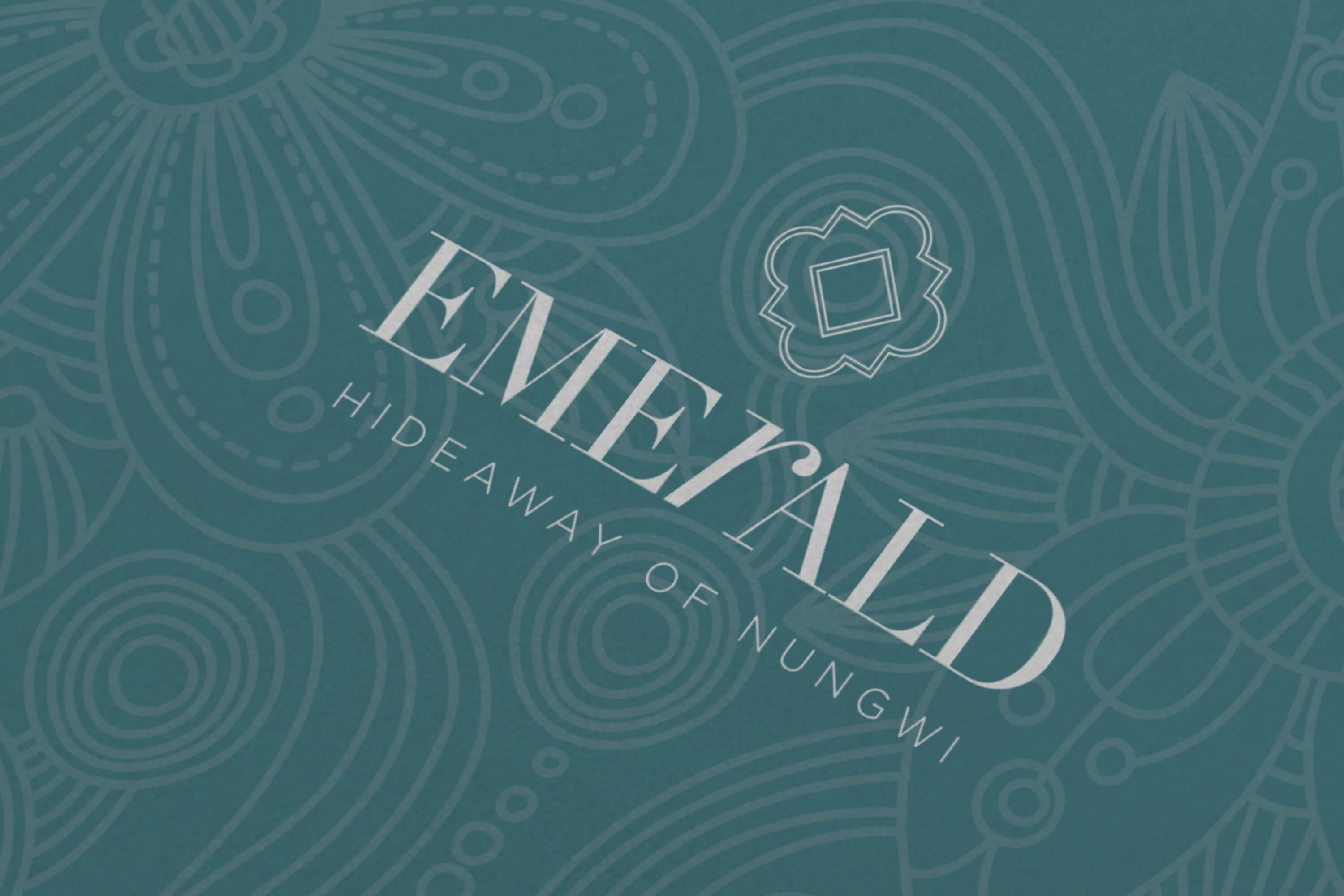 Close up of the JLL Emerald Resorts corporate brochure logo design