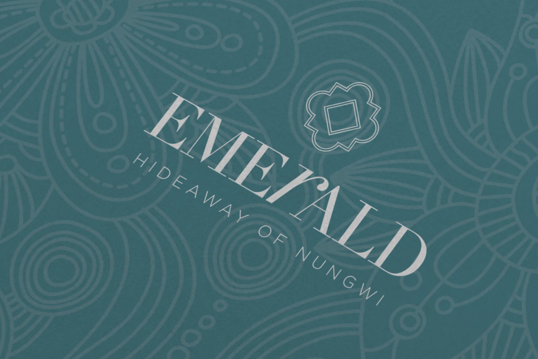 Close up of the JLL Emerald Resorts corporate brochure logo design