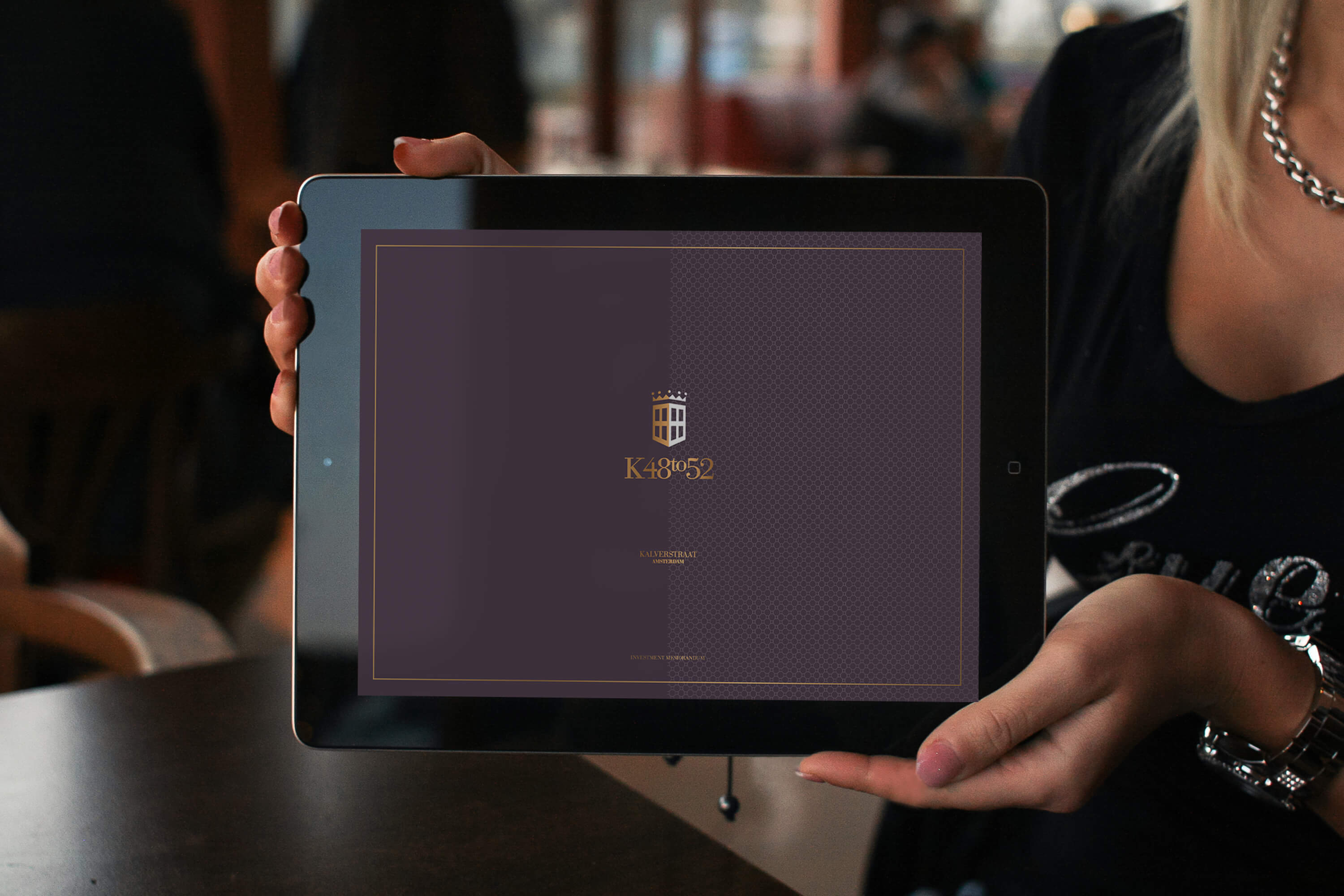 A tablet displaying the front cover design for the JLL K48to52 investment memorandum design