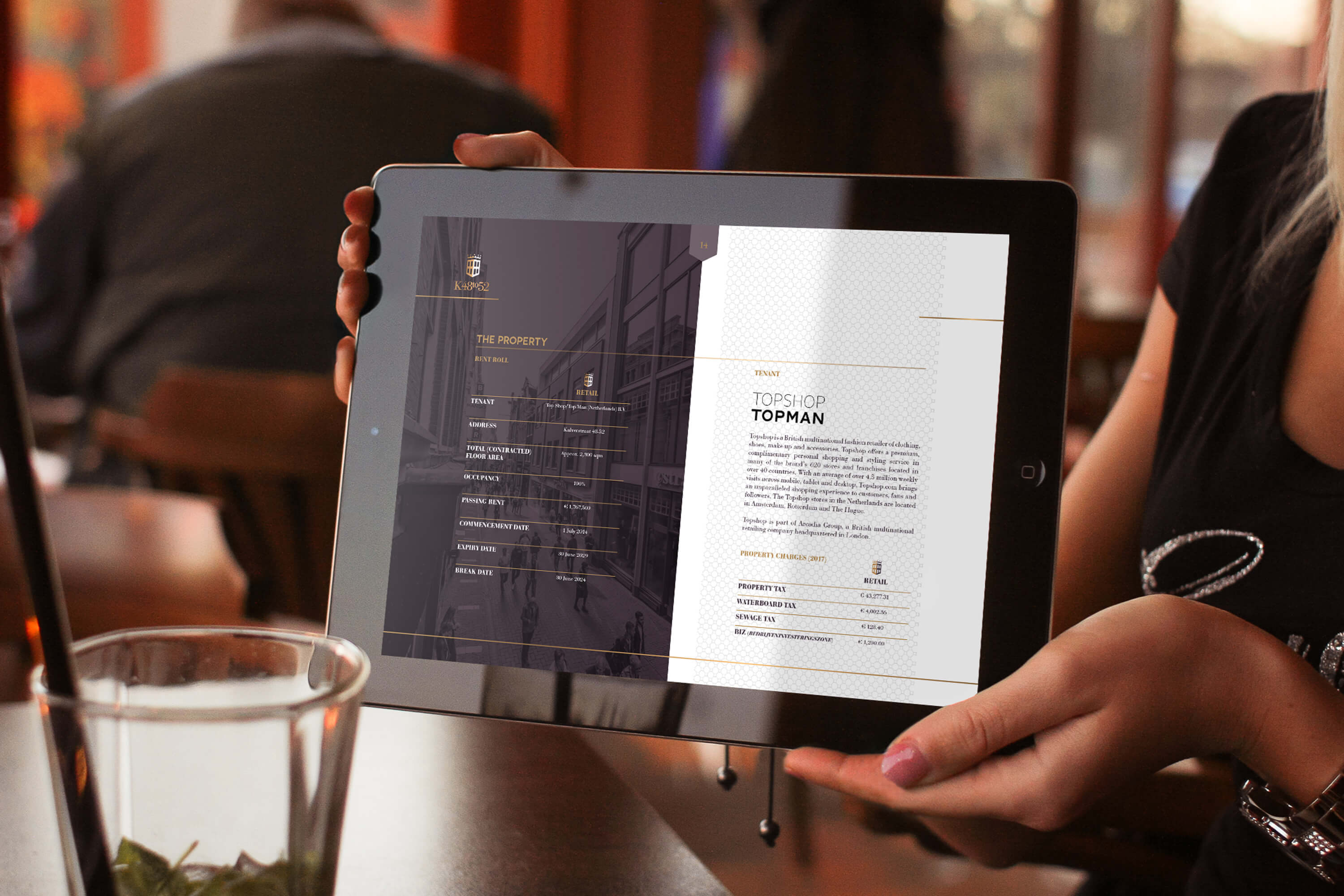 A woman holding a tablet showing an internal page within the JLL K48to52 investment memorandum design