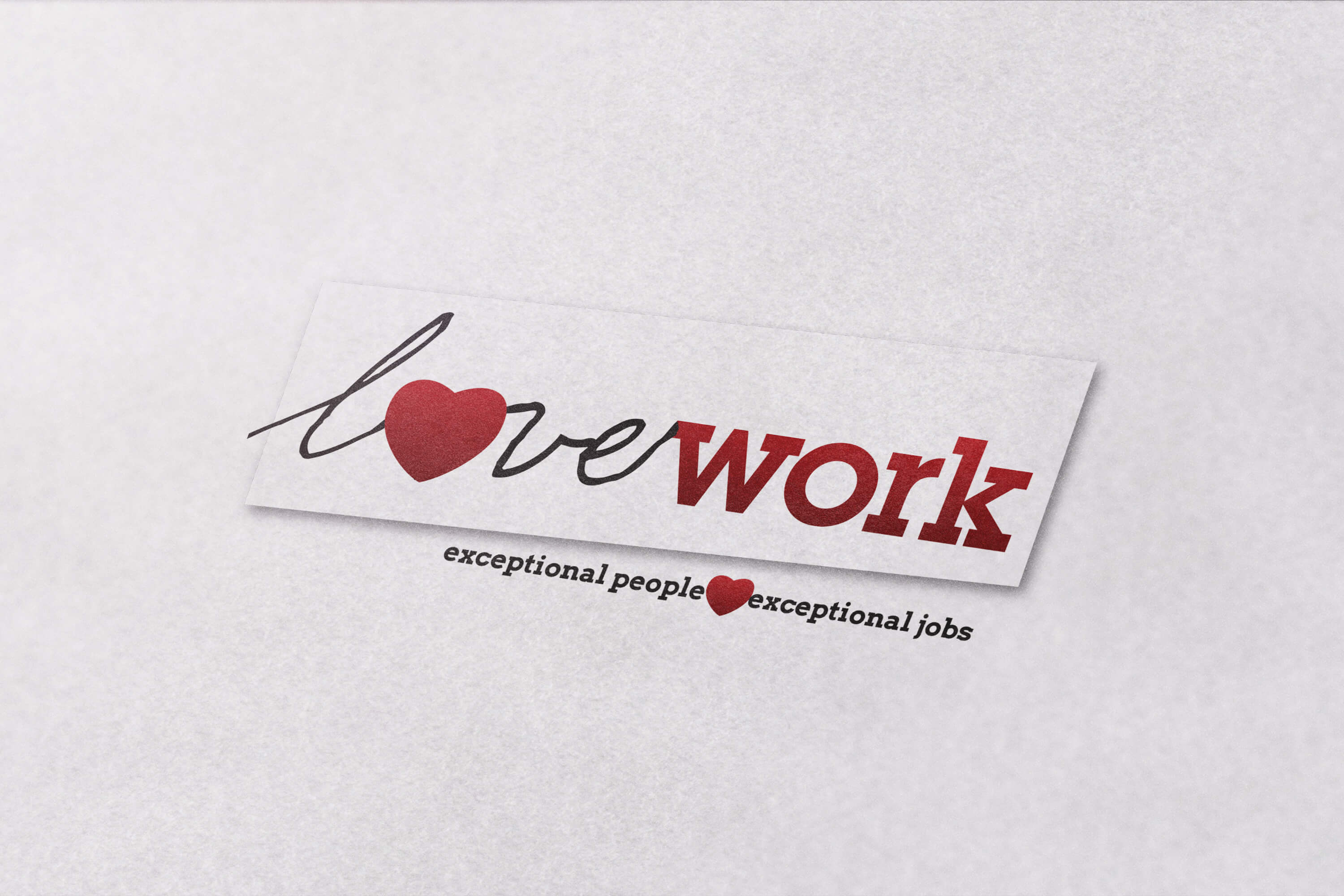 Close up of the Lovework logo design printed on paper