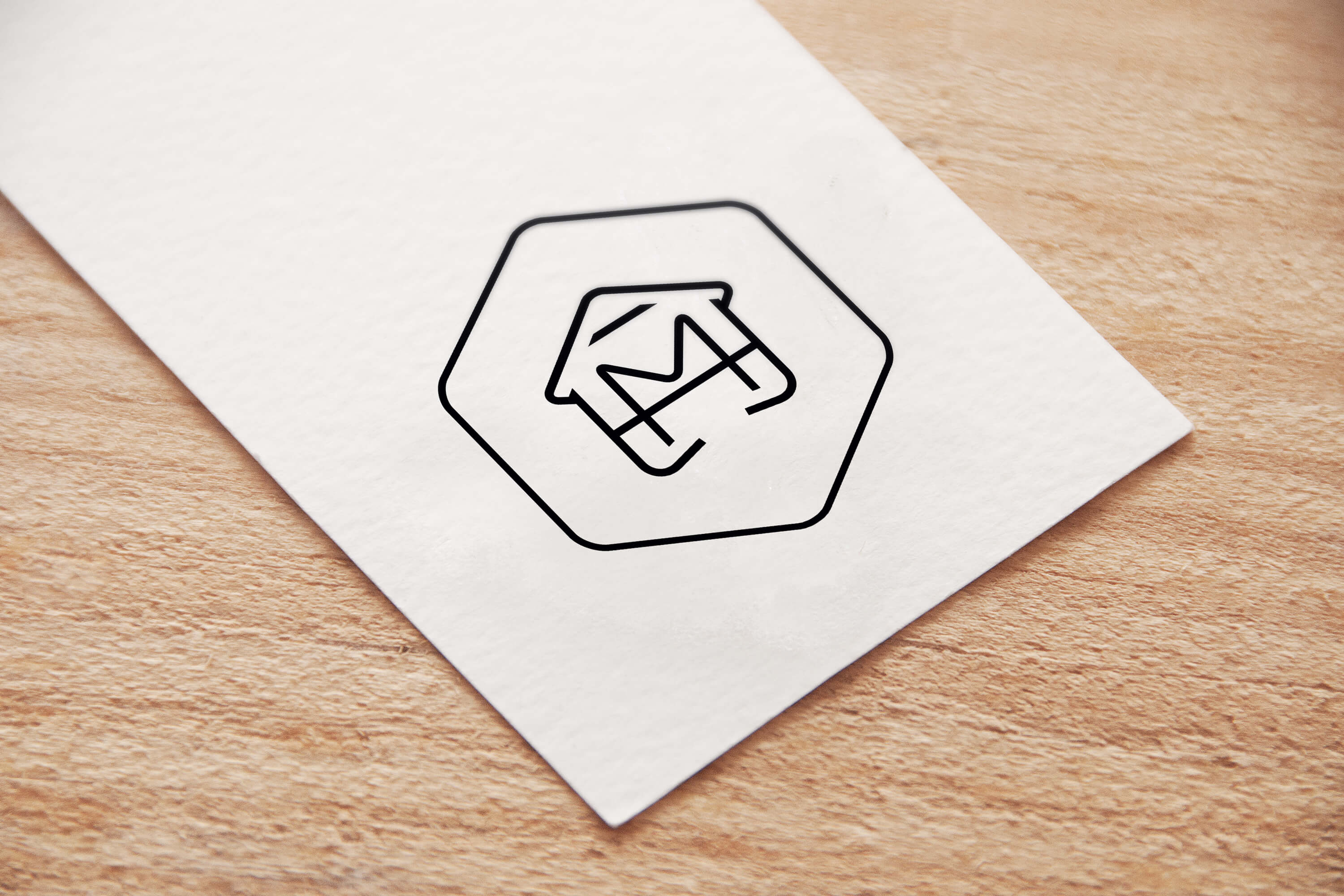 Close up a printed paper tag showing a variation of the Make My House Home logo