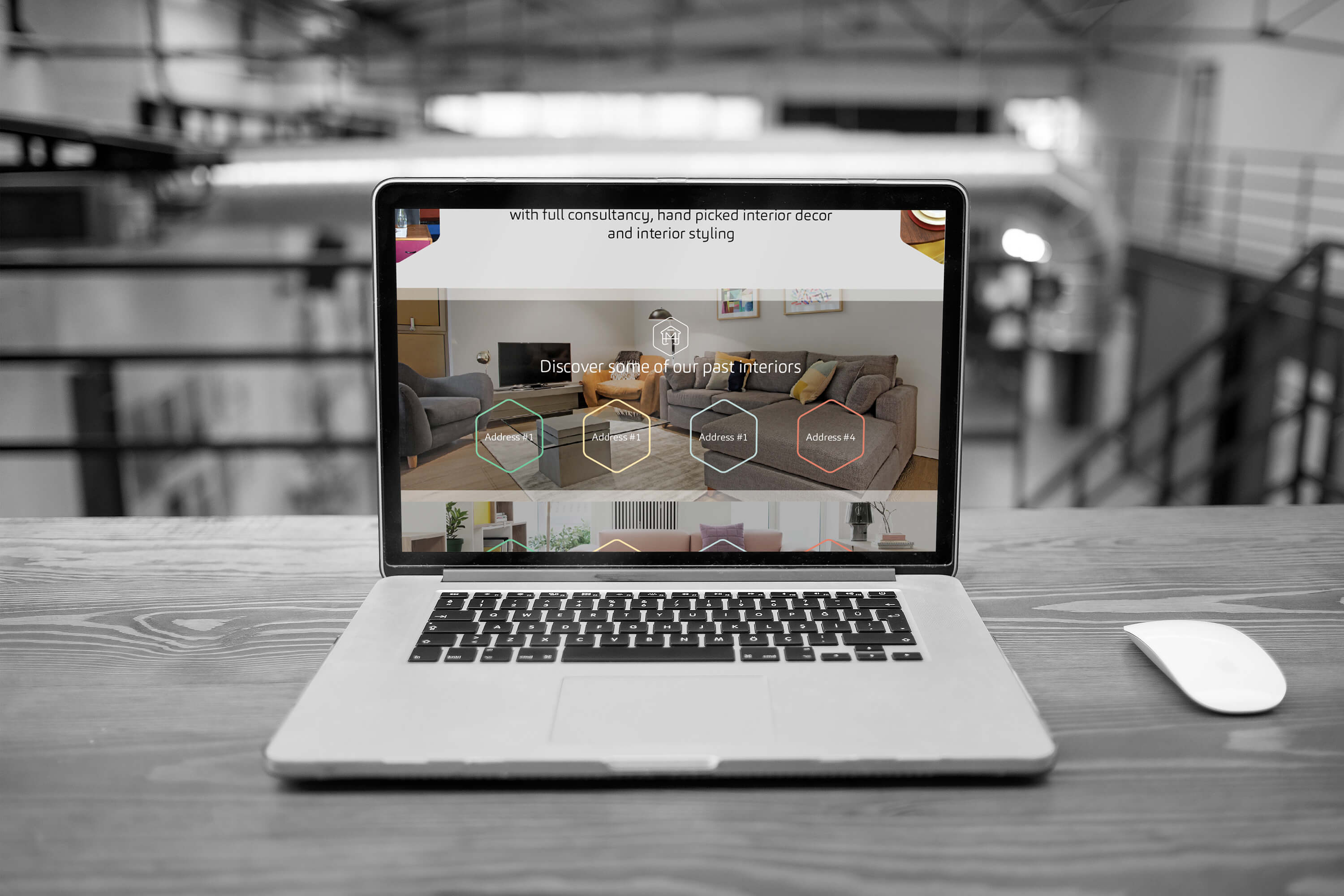 A laptop on a desk showing the Make My House Home interior page design
