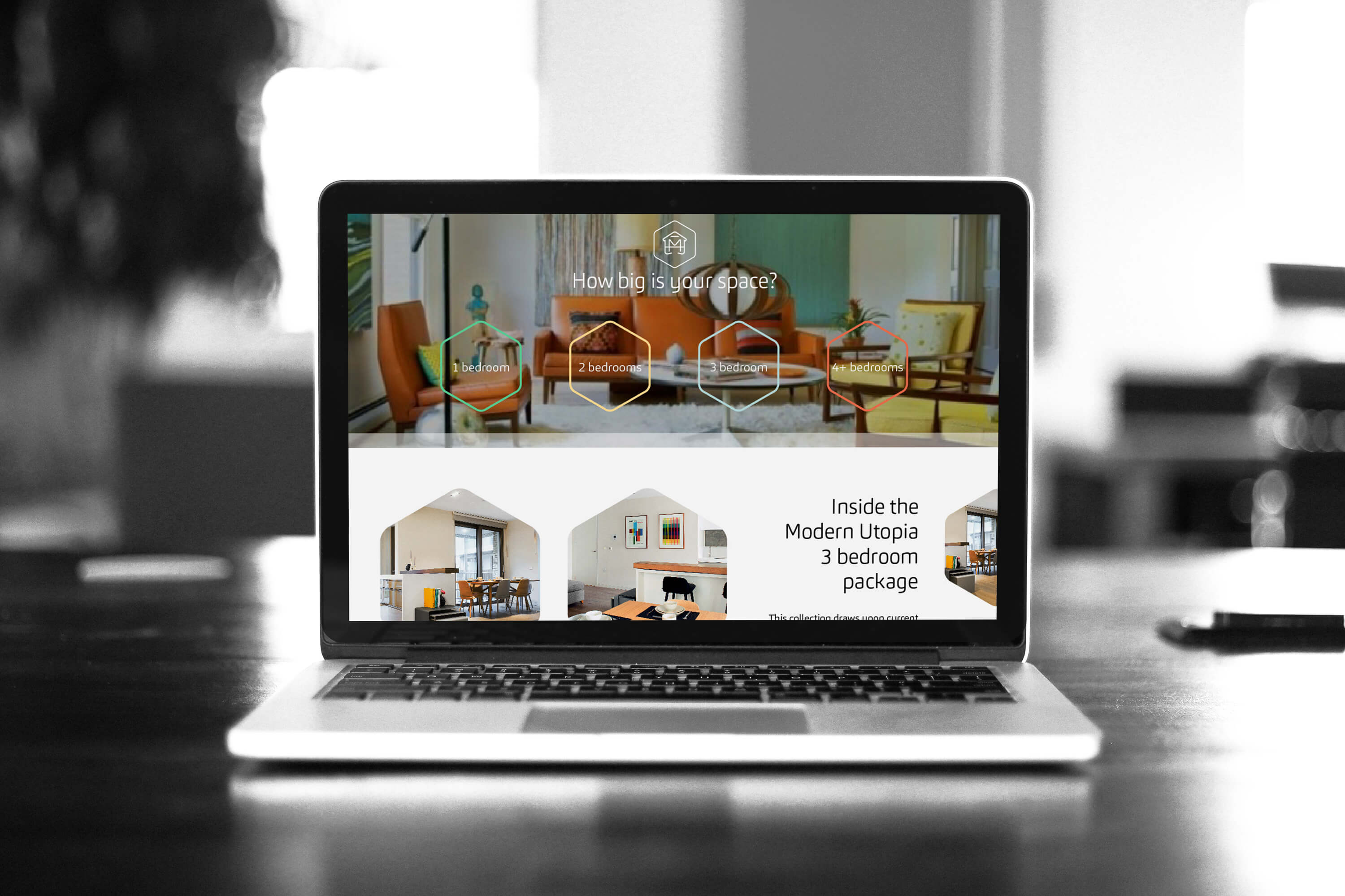 Laptop showing the packages page on the Make My House Home website