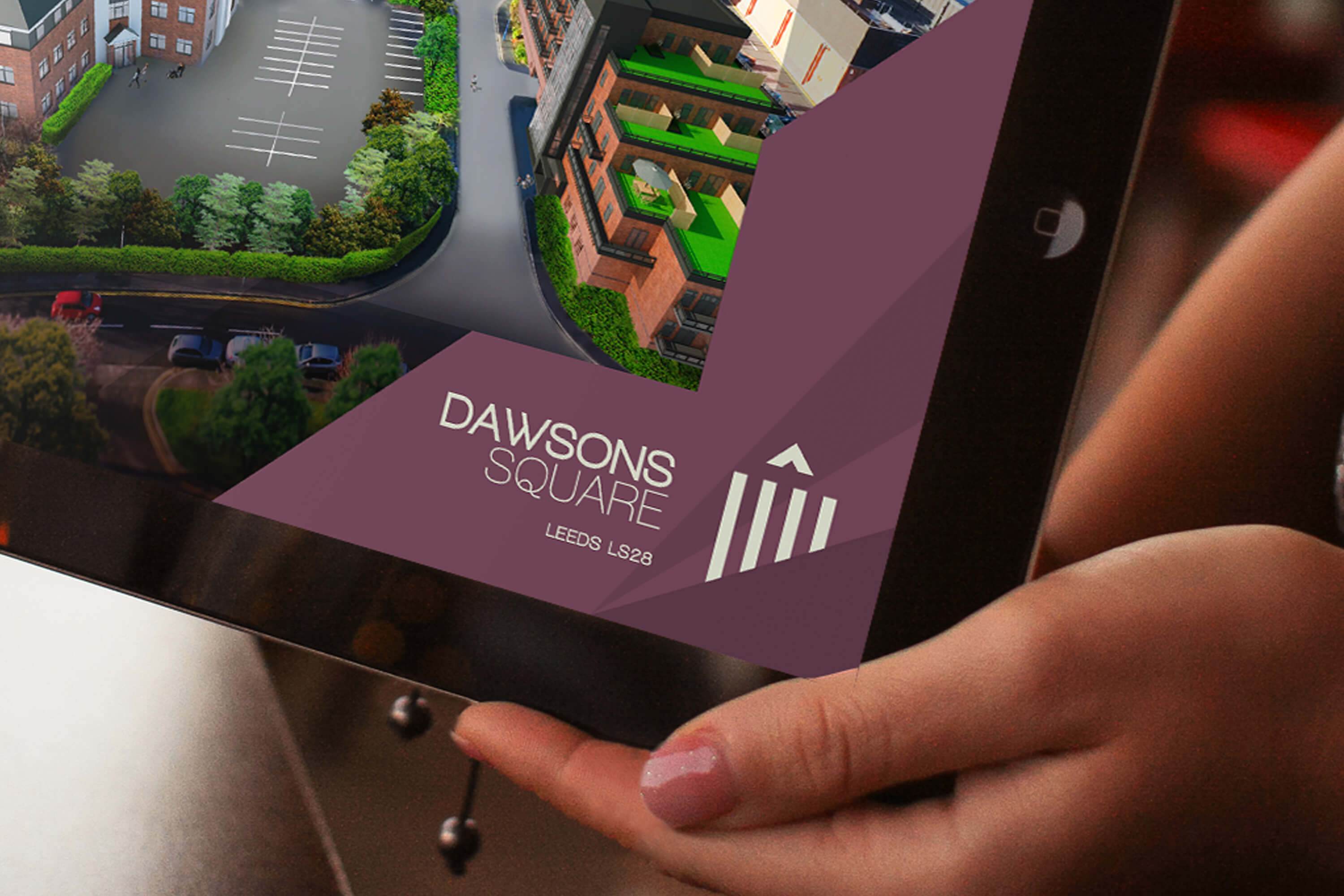 Close up of a tablet corner, showing the Dawsons Square brand design