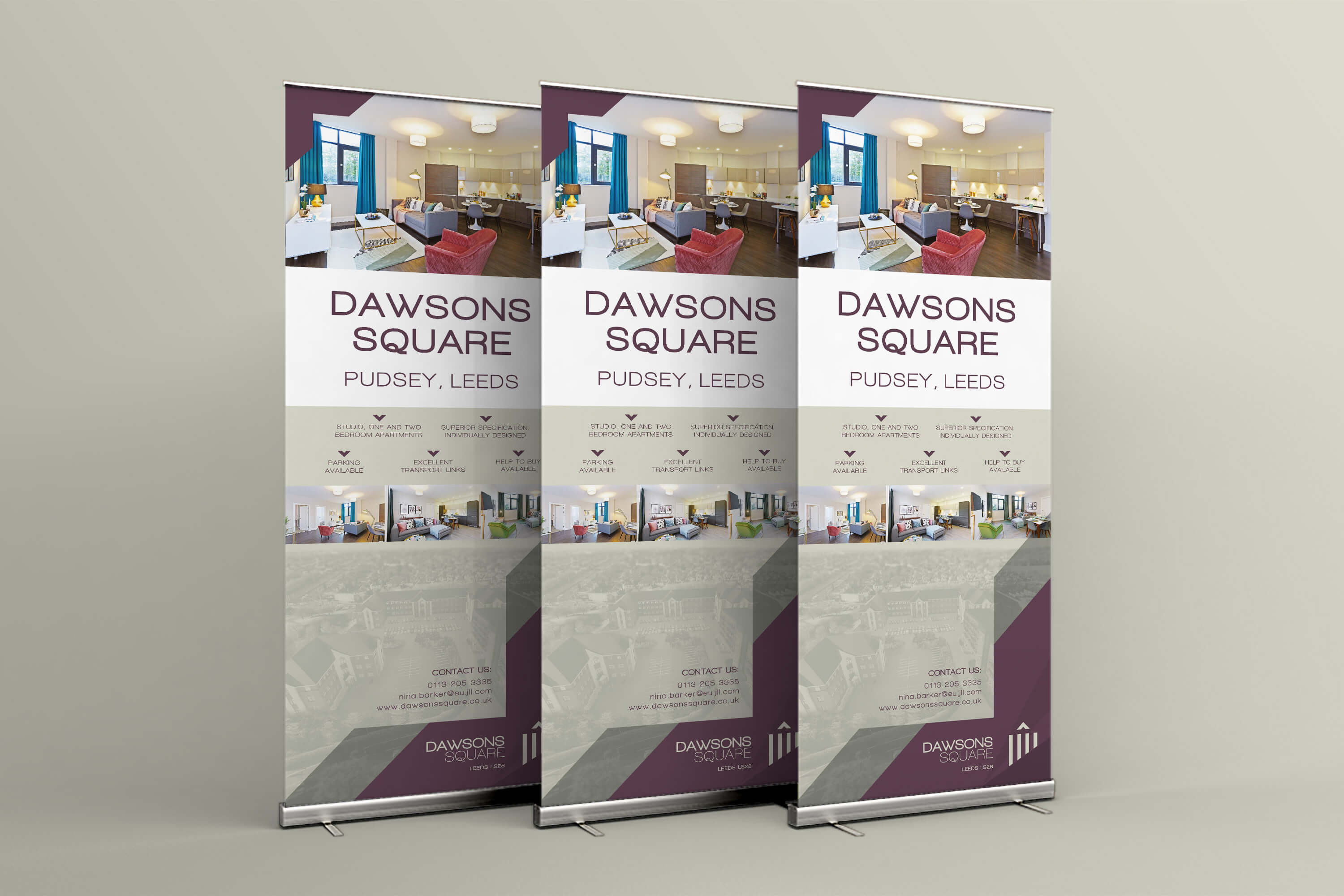 A group of three roller banners with Dawsons Square branding and marketing