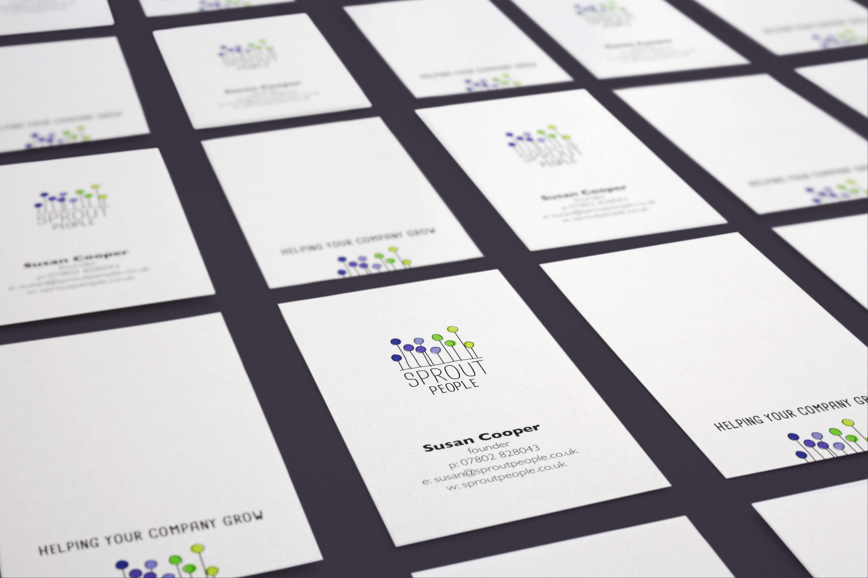 Multiple cards displaying the Sprout People brand identity on the front and back of business cards