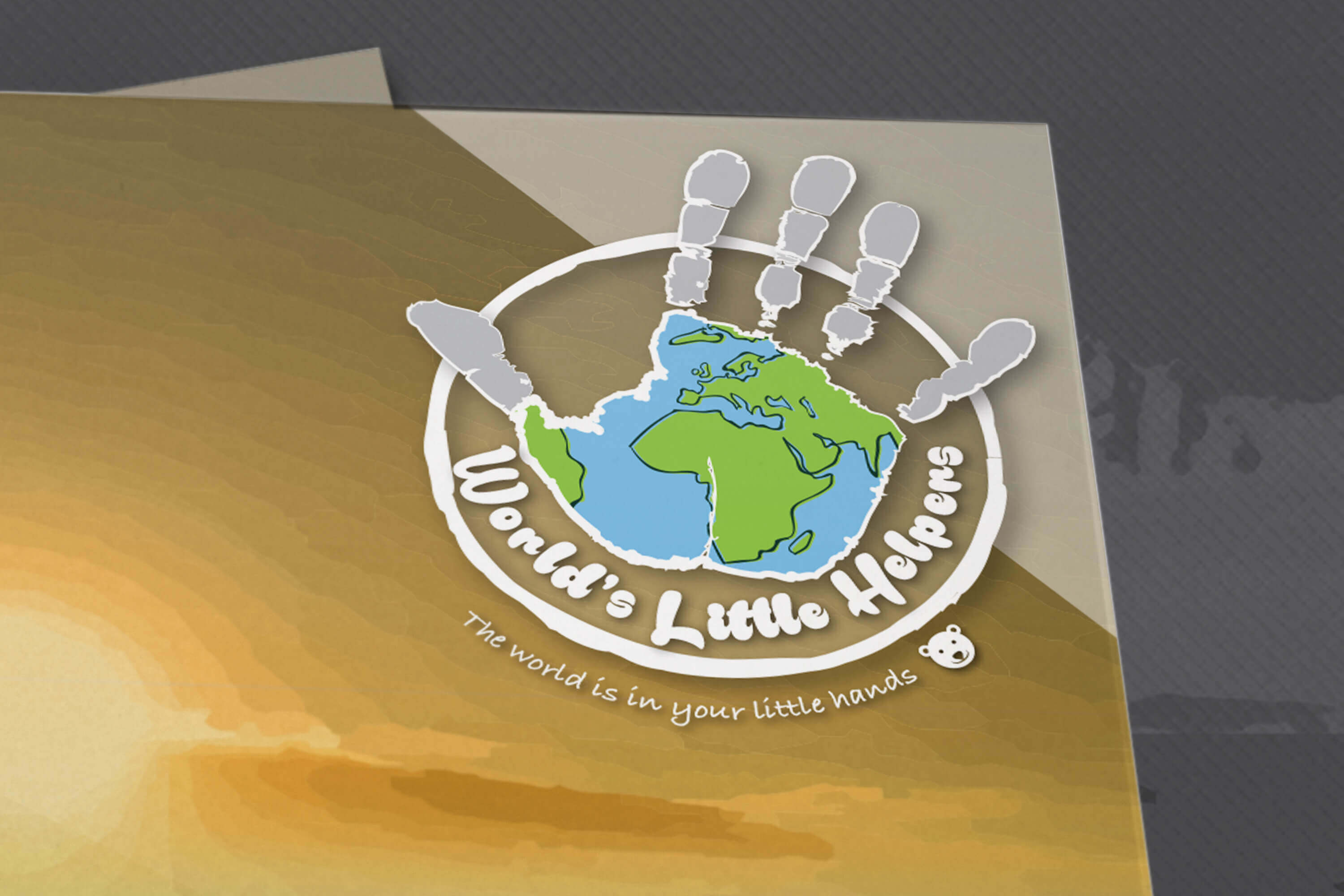 Close up of World's Little Helpers magazine logo on cover of the magazine