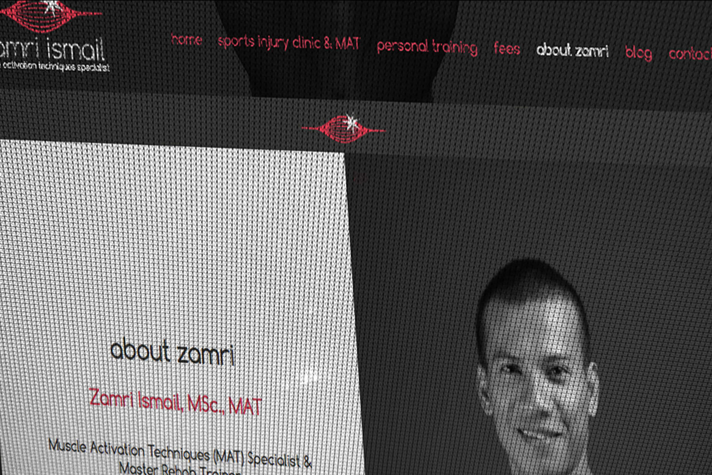 Close up detail of the Zamri Ismail website as it appears on screen